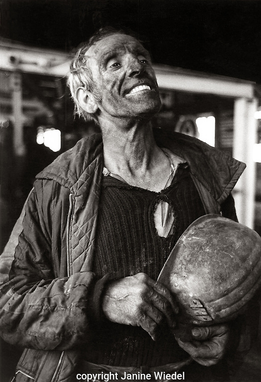 Miner coming out of the cage after days work down the mine shaft Florence Colliery   Staffordshire. 1970's