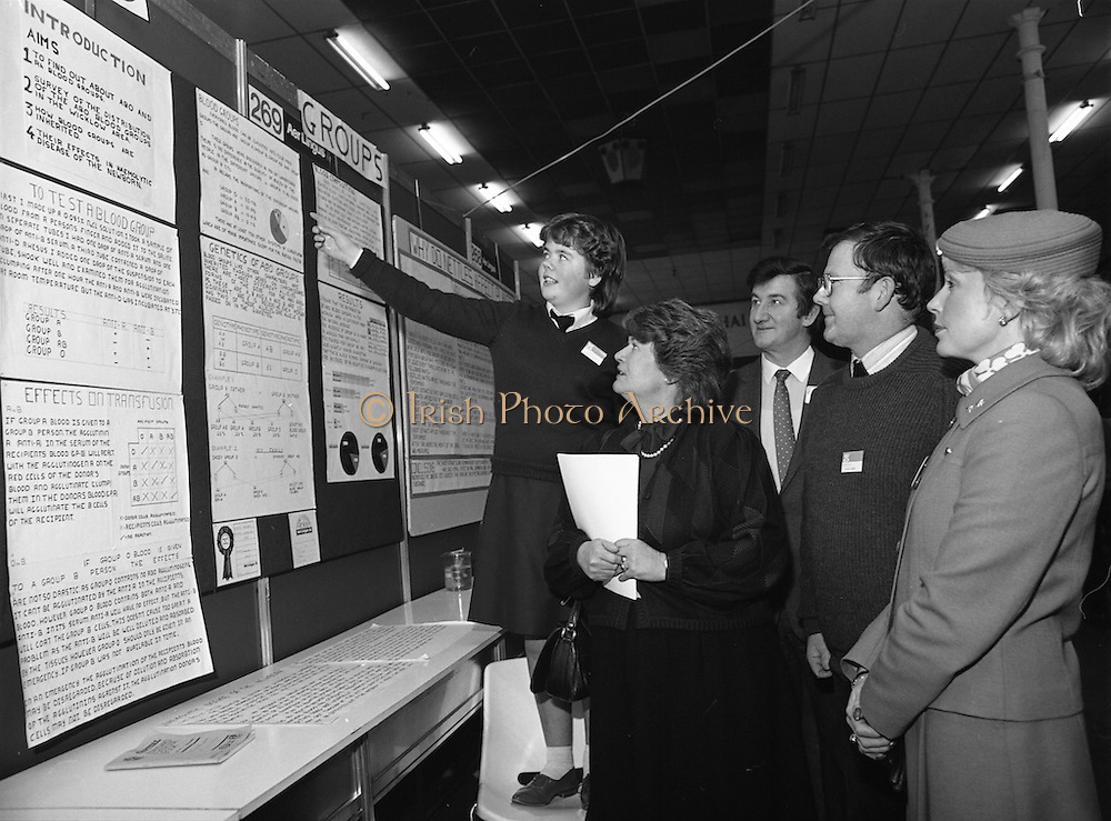 11/01/1985.01/11/1985.11th January 1985.The Aer Lingus Young Scientist Exhibition at the RDS Dublin...Imelda Shortt (left) of the Vocational School, Wicklow, showing her Individual Project on 'Blood Transfusion' at the Aer Lingus Young Scientist Exhibition to Gemma Hussey, T.D. Minister for Education during her visit to the stands with (from right), Aer Lingus Hostess Sally Ann Flanagan; Patrick Maher, Teacher and Donal Dowling, Assistant Chief Executive, Aer Lingus.