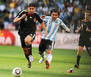 CAPE TOWN, SOUTH AFRICA- Saturday 3 July 2010, Carlos Tevez (without shoe) challenges Sami Khedira during the quarter final match between Argentina and Germany held at the Cape Town Stadium in Green Point during the 2010 FIFA World Cup..Photo by Roger Sedres/Image SA