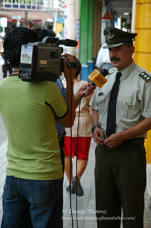 TV interview with policeman in Santa Cruz, Bolivia