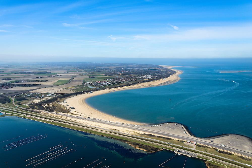 Nederland, Zeeland, Gemeente Schouwen-Duiveland, 01-04-2016; Brouwersdam, onderdeel van de Deltawerken, tussen Goeree en Schouwen-Duiveland (aan de horizon). Na het afsluiten van de zeearm Grevelingen is het Grevelingenmeer ontstaan, links van de dam, het grootste zoutwatermeer van West-Europa. Rechts de Noordzee, in het midden de inlaar voor zout water.<br /> <br /> Brouwers dam, part of the Delta Works, between Goeree and Schouwen-Duiveland (on the horizon). Closing the estuary resulted in the Grevelingen lake, the largest saltwater lake in Western Europe.<br /> <br /> luchtfoto (toeslag op standard tarieven);<br /> aerial photo (additional fee required);<br /> copyright foto/photo Siebe Swart