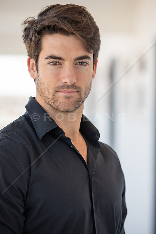 portrait of a handsome man with brown hair and brown eyes