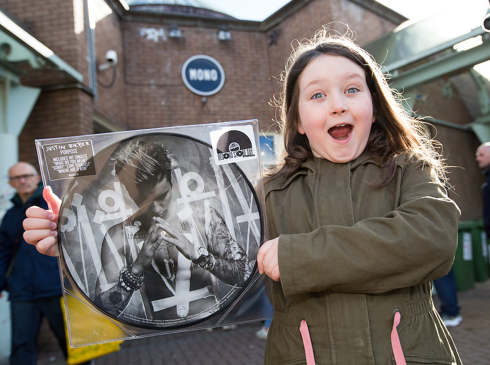Record Store Day. Queues outside Mono on King Street , Glasgow. A delighted Ellie Barr (8) from Hyndland, Glasgow is over the moon having managed to get one of only 3 copies of Justin Bieber's album Purpose. Picture Robert Perry 16th April 2016<br /> <br /> Must credit photo to Robert Perry<br /> FEE PAYABLE FOR REPRO USE<br /> FEE PAYABLE FOR ALL INTERNET USE<br /> www.robertperry.co.uk<br /> <br /> NB -This image is not to be distributed without the prior consent of the copyright holder.<br /> in using this image you agree to abide by terms and conditions as stated in this caption.<br /> All monies payable to Robert Perry<br /> <br /> (PLEASE DO NOT REMOVE THIS CAPTION)<br /> This image is intended for Editorial use (e.g. news). Any commercial or promotional use requires additional clearance. <br /> Copyright 2016 All rights protected.<br /> first use only<br /> contact details<br /> Robert Perry     <br /> 07702 631 477<br /> robertperryphotos@gmail.com<br />        <br /> Robert Perry reserves the right to pursue unauthorised use of this image . If you violate my intellectual property you may be liable for  damages, loss of income, and profits you derive from the use of this image.