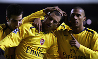 Photo: Paul Thomas.<br /> Liverpool v Arsenal. Carling Cup. 09/01/2007.<br /> <br /> Arsenal celebrate Julio Baptista's (L out of picture) fourth goal by congratulating Jeremie Alladiere (C) who set it up.