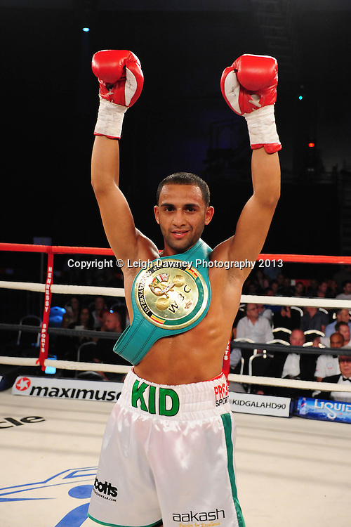 Kid Galahad defeats Isaac Nettey after a technical knockout for Super Bantamweight contest at Glow, Bluewater, Dartford, Kent, UK on 8th June 2013. Promoter: Hennessy Sports. Mandatory Credit: © Leigh Dawney