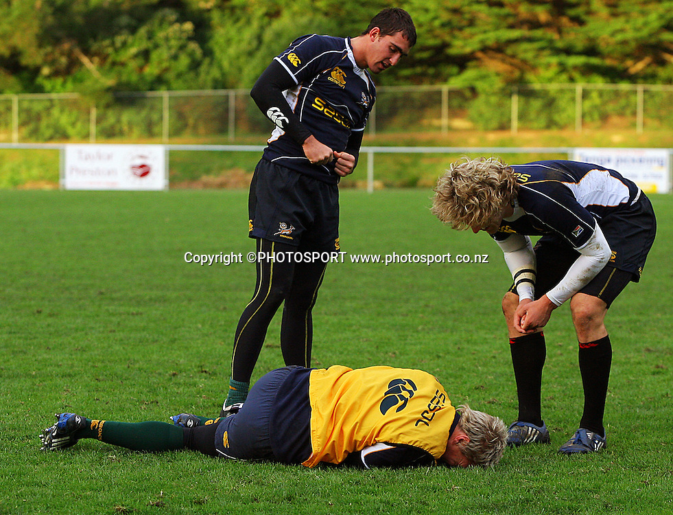 Jean De Villiers feigns injury after being dumped  by Frans Steyn as co-culprit Ruan Pienaar looks on.<br /> South Africa Rugby Training at Porirua Park, Wellington, New Zealand, Monday 7 July 2008. Photo: Dave Lintott/PHOTOSPORT