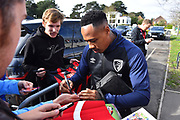 Nathaniel Clyne (23) of AFC Bournemouth signs his autograph as he arrives at the Vitality Stadium before the Premier League match between Bournemouth and Manchester City at the Vitality Stadium, Bournemouth, England on 2 March 2019.