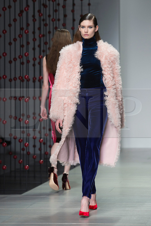 © Licensed to London News Pictures. 15 February 2014, London, England, UK. A model walks the runway at the Emilio de la Morena show during London Fashion Week AW14 at the BFC Courtyard Show Space/Somerset House. Photo credit: Bettina Strenske/LNP