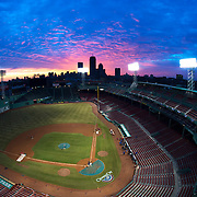 BOSTON, MA - APRIL 4:  The sun rises over Fenway Park on opening day on April 4, 3014 in Boston, Masschusetts. The Milwaukee Brewers will face the Boston Red Sox in the first of a three game series.  (Photo by Michael Ivins/Boston Red Sox/Getty Images) *** Local Caption ***Fenway Park