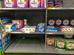 © Licensed to London News Pictures. 03/03/2020. London, UK. Loo roll unning low. Panic-buying starts to show in this ASDA store in Wandsworth as shelves empty out of goods. Earlier, Boris Johnson announced his battle plan in Downing Street for combating the coronavirus crisis. Photo credit: Alex Lentati/LNP