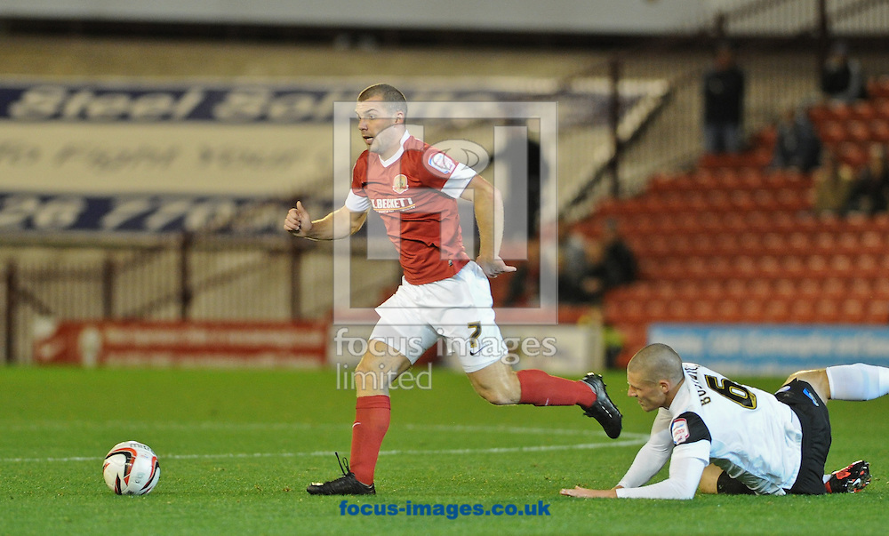 Picture by Richard Land/Focus Images Ltd +44 7713 507003.02/10/2012.Stephen Dawson of Barnsley and Michael Bostwick of Peterborough United during the npower Championship match at Oakwell, Barnsley.