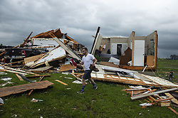 May 29, 2019, Bonner Springs, Kansas, U.S.: TANNER BEAM helps carry belongings from a home hit by a tornado west of Bonner Springs, Kansas. The home belonged to Travis and Kay Boatwright who rode out the storm with their 14-year-old son Jacob in the basement. They escaped unharmed. (Credit Image: © TNS via ZUMA Wire)