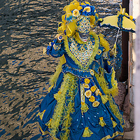 VENICE, ITALY - FEBRUARY 25:  A woman dressed in Carnival Costume poses on the bank of a canal on February 25, 2014 in Venice, Italy. The 2014 Carnival of Venice will run from February 15 to March 4 and includes a program of gala dinners, parades, dances, masked balls and music events.  (Photo by Marco Secchi/Getty Images)
