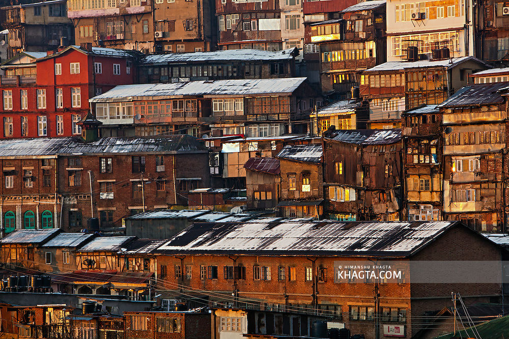 A closer look at the old wooden houses of Shimla City in the sunset light after the city received its first snowfall of the season at New Year.