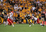 08 SEPTEMBER 2007: Syracuse cornerback Dowayne Davis (26) pulls down Iowa wide receiver Andy Brodell (80) in Iowa's 35-0 win over Syracuse at Kinnick Stadium in Iowa City, Iowa on September 8, 2007.