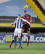 13th February 2018, Rugby Park, Kilmarnock, Scotland; Scottish Premiership football, Kilmarnock versus Dundee; Steven Caulker of Dundee oujumps Lee Erwin of Kilmarnock