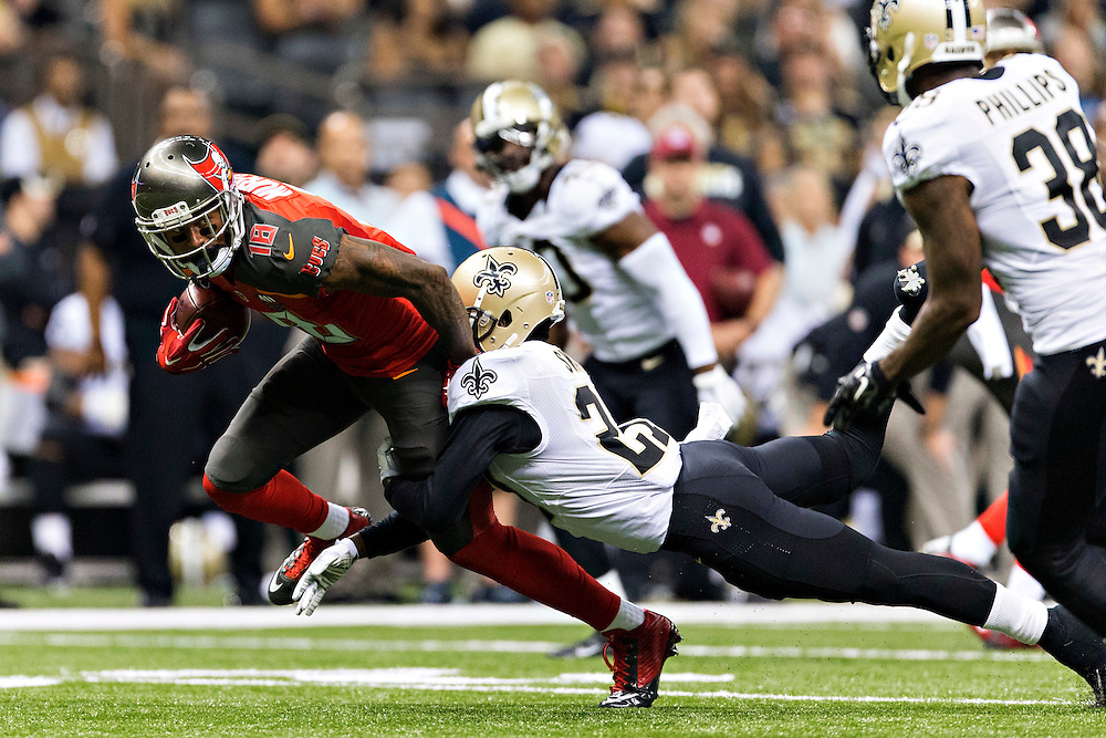 NEW ORLEANS, LA - SEPTEMBER 20:  Louis Murphy #18 of the Tampa Bay Buccaneers is tackled by Damian Swann #27 of the New Orleans Saints at Mercedes-Benz Superdome on September 20, 2015 in New Orleans Louisiana. The Buccaneers defeated the Saints 26-19.   (Photo by Wesley Hitt/Getty Images) *** Local Caption *** Louis Murphy; Damian Swann