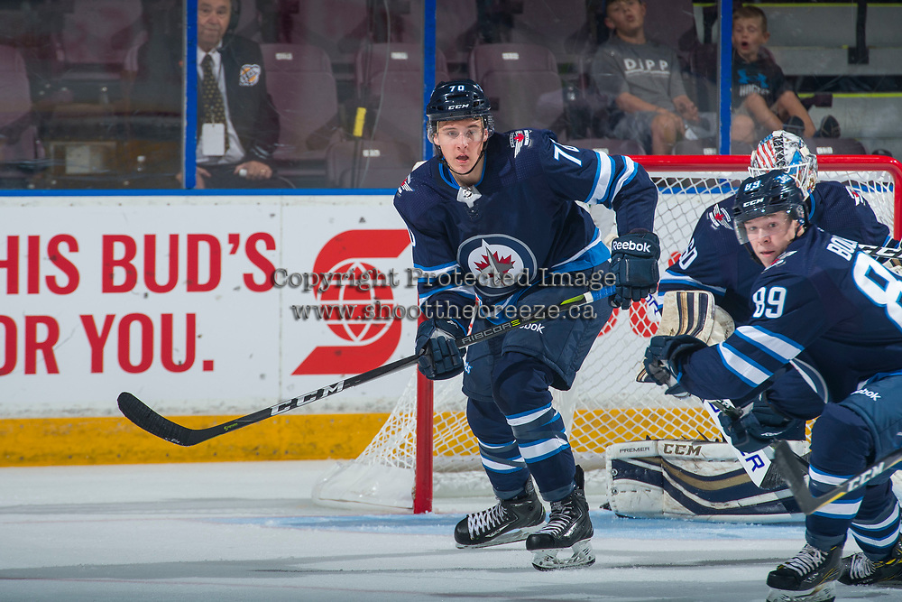 PENTICTON, CANADA - SEPTEMBER 8: Skyler McKenzie #76 of Winnipeg Jets looks for the pass against the Vancouver Canucks on September 8, 2017 at the South Okanagan Event Centre in Penticton, British Columbia, Canada.  (Photo by Marissa Baecker/Shoot the Breeze)  *** Local Caption ***
