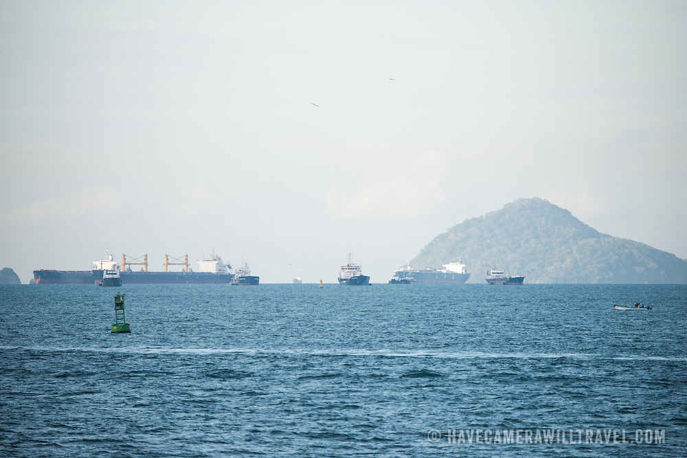 Container and passenger ships at anchor in Panama Bay awaiting their scheduled turn to transit the Panama Canala from south to north.