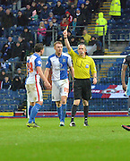 Blackburn Rovers Defender, Corry Evans is yellow carded by ref Frederick Graham during the Sky Bet Championship match between Blackburn Rovers and Sheffield Wednesday at Ewood Park, Blackburn, England on 28 November 2015. Photo by Mark Pollitt.