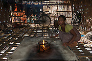 Mising woman in house<br /> Mising Tribe (Mishing or Miri Tribe)<br /> Majuli Island, Brahmaputra River<br /> Largest river island in India<br /> Assam,  ne India