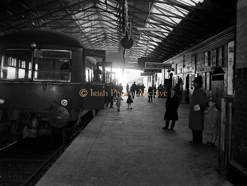 Last Train leaves Harcourt Station.31/12/1958..From the Irish Independent on New Year's Day 1959:..?An hour after the last train had left Harcourt Station at 4.25 p.m. yesterday the 100-year-old terminus bore a derelict look as a sad-faced staff locked up for the last time. The departure of the last train will be long remembered by hundreds of people for among the 500 passengers, there were young children who were having their first and last train journey on that route. Hundreds of people gathered at the station and outside to watch the end of the service. As the train moved out promptly on schedule fog signals exploded and passengers waved to the crowds on the platform..With tears in her eyes, Mrs Maggie McLoughlin, of York St., who had been selling newspapers at the station for 39 years, said good-bye alone and unnoticed in a corner of the station..At Bray hundreds of people were waiting on the station to greet the train as it arrived. Some young men attempted to remove fittings as souvenirs but were prevented by the Gardaí on duty.?..