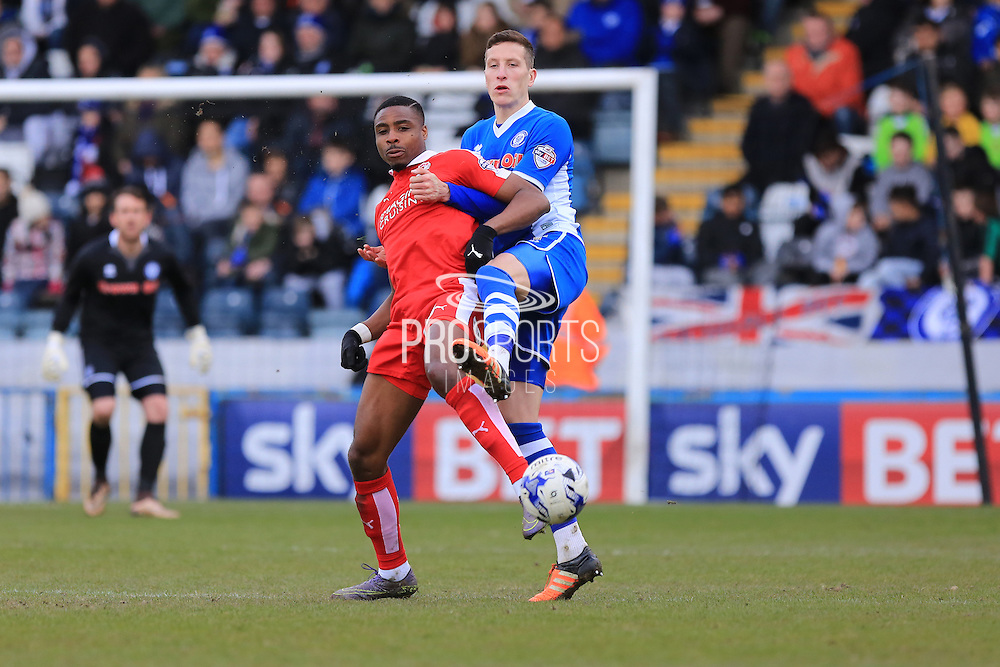 Jon Obika, Jim McNulty during the Sky Bet League 1 match between Rochdale and Swindon Town at Spotland, Rochdale, England on 30 April 2016. Photo by Daniel Youngs.