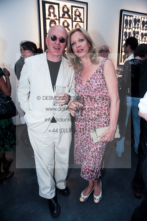 JOHN PEARSE and MARY GREENWELL at a private view of photographs by David Bailey entitled 'Then' held at Hamiltons, 13 Carlos Place, London W1 on 6th July 2010.