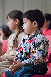 Children in the audience watching a performance celebrating Diwali; Festival of Light,