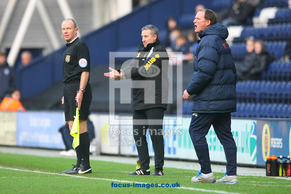 Norwich Manager Neil Adams and Preston Manager Simon Grayson during the FA Cup match at Deepdale, Preston<br /> Picture by Paul Chesterton/Focus Images Ltd +44 7904 640267<br /> 03/01/2015