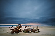 Lying in a sandy graveyard, a cloudy dawn breaks on the remains of the Volo Shipwreck. A less painful echo the violent storm that brought it onto the shores of Kwaaihoek and Boesmansriveirmond in 1896.