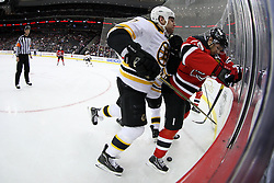 Jan 19; Newark, NJ, USA; Boston Bruins left wing Milan Lucic (17) hits New Jersey Devils defenseman Mark Fayne (29) during the first period at the Prudential Center.