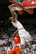 FAYETTEVILLE, AR - NOVEMBER 30:  BJ Young #11 of the Arkansas Razorbacks goes up for a dunk against the Syracuse Orangemen at Bud Walton Arena on November 30, 2012 in Fayetteville, Arkansas.  The Orangemen defeated the Razorbacks 91-82.  (Photo by Wesley Hitt/Getty Images) *** Local Caption *** BJ Young
