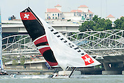 Alinghi come close to capsizing on day two of the Extreme Sailing Series regatta being sailed in Singapore. 21/2/2014