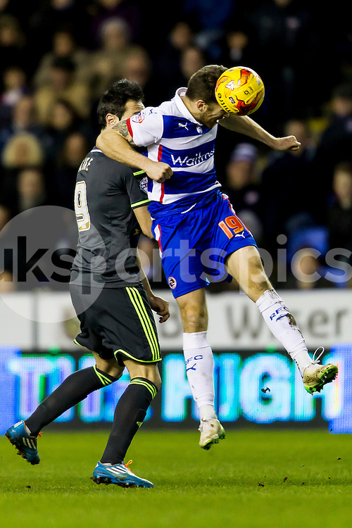 Jamie Mackie of Reading challenges for the ball during the Sky Bet Championship match between Reading and Middlesbrough at the Madejski Stadium, Reading, England on 10 January 2015. Photo by Gareth  Brown.