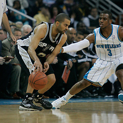 29 March 2009: San Antonio Spurs guard Tony Parker (9) is guarded by New Orleans Hornets guard Chris Paul (3) during a 90-86 victory by the New Orleans Hornets over Southwestern Division rivals the San Antonio Spurs at the New Orleans Arena in New Orleans, Louisiana.