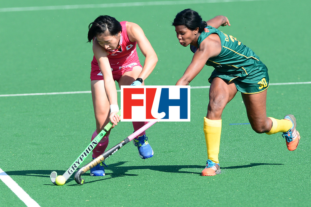 JOHANNESBURG, SOUTH AFRICA - JULY 22: Sulette Damons of South Africa tackles Mami Karino of Japan during day 8 of the FIH Hockey World League Women's Semi Finals 5th-6th place match between Japan and South Africa at Wits University on July 22, 2017 in Johannesburg, South Africa. (Photo by Getty Images/Getty Images)