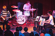 From left, guitarist and vocalist Tommy Siegel, drummer Jesse Kristin, and pianist and vocalist Ben Thornewill of Jukebox the Ghost perform at Water Street Music Hall in Rochester, New York on December 11, 2010.