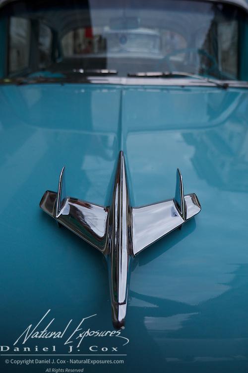Hood ornament of a vintage Chevy BelAir on the streets o Havana, Cuba.