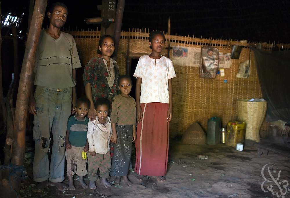 Coffee farmer Hagirso Funte (age 32), his wife and four children are seen February 23, 2007 in their home in the Sidamo coffee region of southern Ethiopia near the town of Yirgalem. Funte struggles to make enough money through coffee farming and says that coffee prices earned by Ethiopian farmers need to increase in order for him to get ahead.