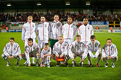VADUZ, LIECHTENSTEIN - Wednesday, October 14, 2009: Wales' players line-up for a team group photograph before the 2010 FIFA World Cup Qualifying Group 4 match against Liechtenstein at the Rheinpark Stadion. Back row L-R: David Edwards, Craig Morgan, goalkeeper Boaz Myhill, Ashley Williams, Jermaine Easter. Front row L-R: Chris Gunter, Gareth Bale, mascot, captain James Collins, Simon Church, Aaron Ramsey, David Vaughan. (Pic by David Rawcliffe/Propaganda)