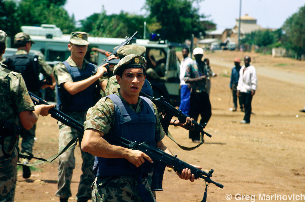 Bekkersdal, Transvaal, South Africa 1994. Police patrol during clashes between police, army, Azapo and the ANC is Bekkersdal township, 1994.