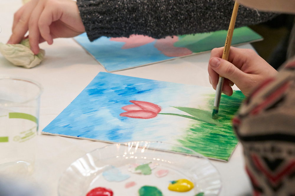 "Moms and their children gather for ""Paint with Pinot"", an event benefiting ""Expanding YOUR Horizons"". Expanding YOUR Horizons is a local orginization devoted to developing self-esteem, self-determination, and independence within adults with cognitive and developmental disabilities."