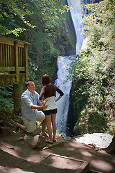 Travis surprised Kim by popping the question at Bridal Veil Falls on July 15, 2009