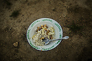 A meal of corn, rice, potatoes and eggs lies in the plate of a protester that entered the Conga complex of lagoons to check the works are still stalled in Conga, Peru, Tuesday, October 20, 2015.(Hilaea Media/ Dado Galdieri)