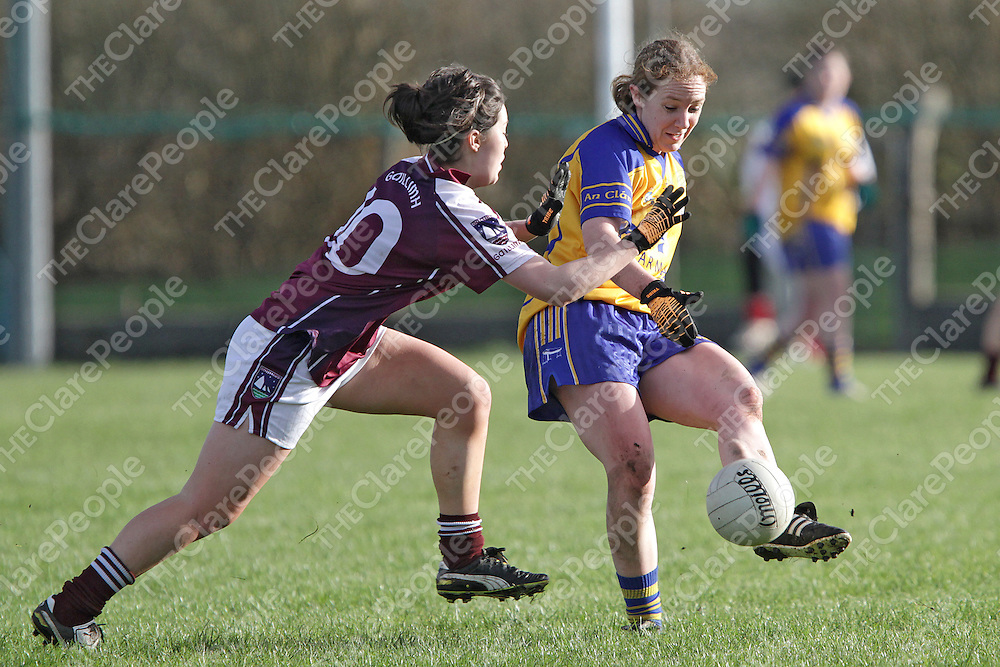 Clare's Louise Henchy gets her pass away under pressure from Galway's Deirdre Brennan during their Bord G&aacute;is Energy Ladies Football League Division 2 Round 3 clash @ Doonbeg. <br /> Photograph by Flann Howard