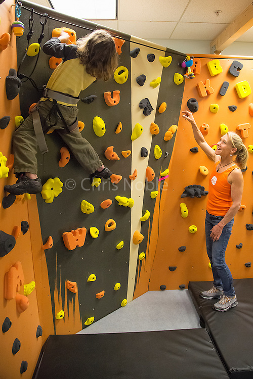 Robyn Erbesfiled-Raboutou teaching children to climb during the dedication of her ABC For Kids Climbing program at Momentum Climbing Gym in Sandy Utah.
