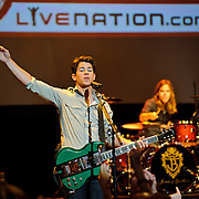 "The Jonas Brothers perform a free concert at the Warner Theater in Washington, D.C.  for their fans in conjunction with Live Nation, who announced a speacial ""No Ticket Fee"" promotion for June 2010 ."