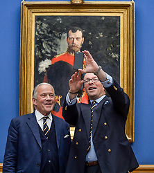 Pictured: Chair of the Board of Trustees at the Royal Scots Dragoon Guards Museum Brigadier Mel Jameson (left) and current Colonel Brigadier David Allfrey (right) take a selfie to mark the moment as the portrait going on display.<br /> <br /> The Scottish National Gallery has unveiled details of a loan deal that will see Valentin Serov's rare portrait of Tsar Nicholas II go on display. The painting is owned by the Royal Scots Dragoon Guards Regimental Trust.<br /> <br /> &copy; Dave Johnston / EEm