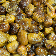 Mountain figs covered with honey from Calabria are displayed at one of the stands of the Biennale del Gusto on October 28, 2013 in Venice, Italy. The Biennale del Gusto is an exhibition held over four days, dedicated to traditional food and drinks from all regions of Italy.